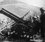 Rok 1940/1941, Albania - Front grecko-włoski - haubica 100/17 Mod.916 na stanowisku w górach.